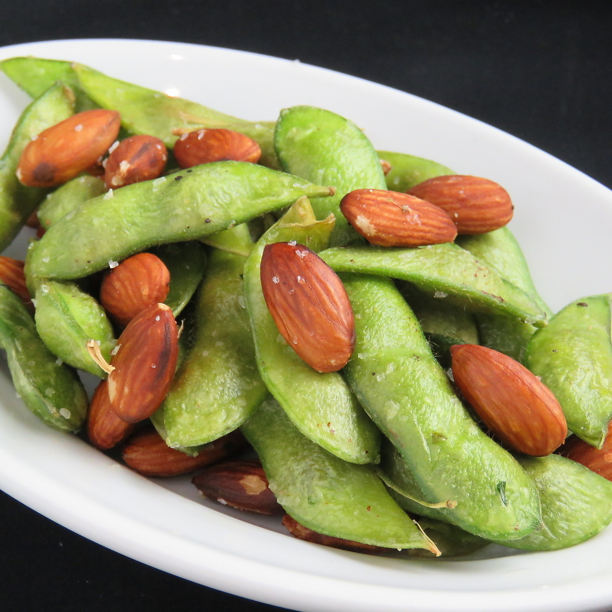 Deep fried green soybeans and almonds