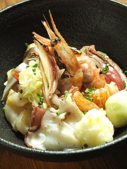 Broiled seafood on rice