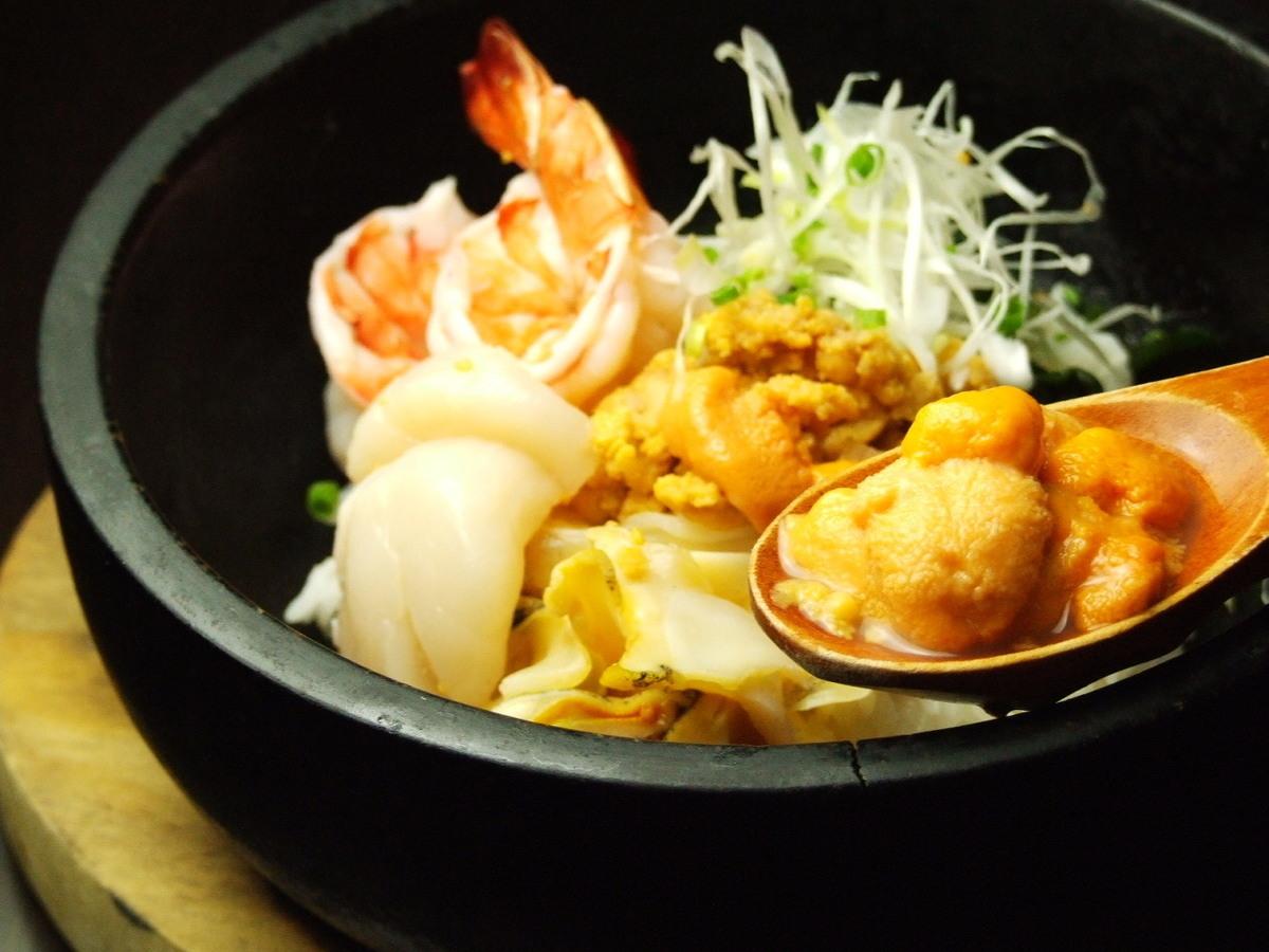 Stone-baked seafood bibimbap ~ Concentrated sea urchin cream sauce ~
