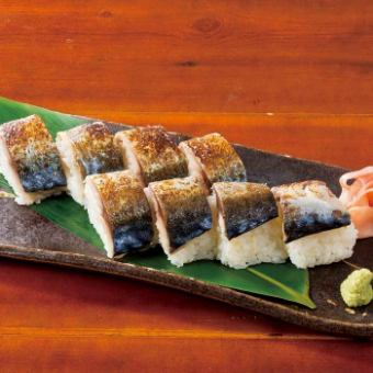 Broiled mackerel's bar stuffed with sushi (one)