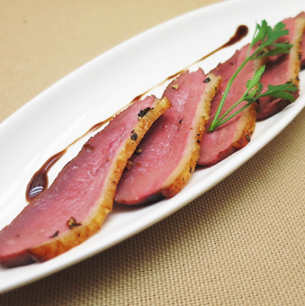 Pastrami of homemak smoked French duck breast meat