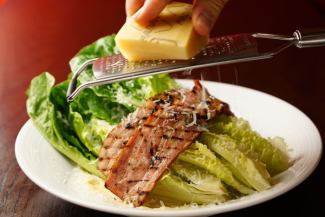 Whole whole romaine lettuce and thick cut bacon Caesar salad