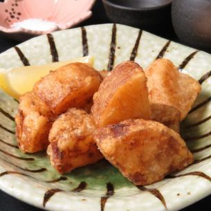 Deep fried radish with oden soup stock