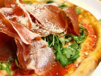 Raw ham and arugula