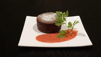 Fondant chocolate with sweet sake berry sauce