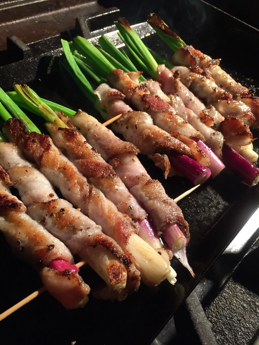 Homemade pancetta wrapped grill of leaves onion from Kyoto Kamo (seasonal specialties)