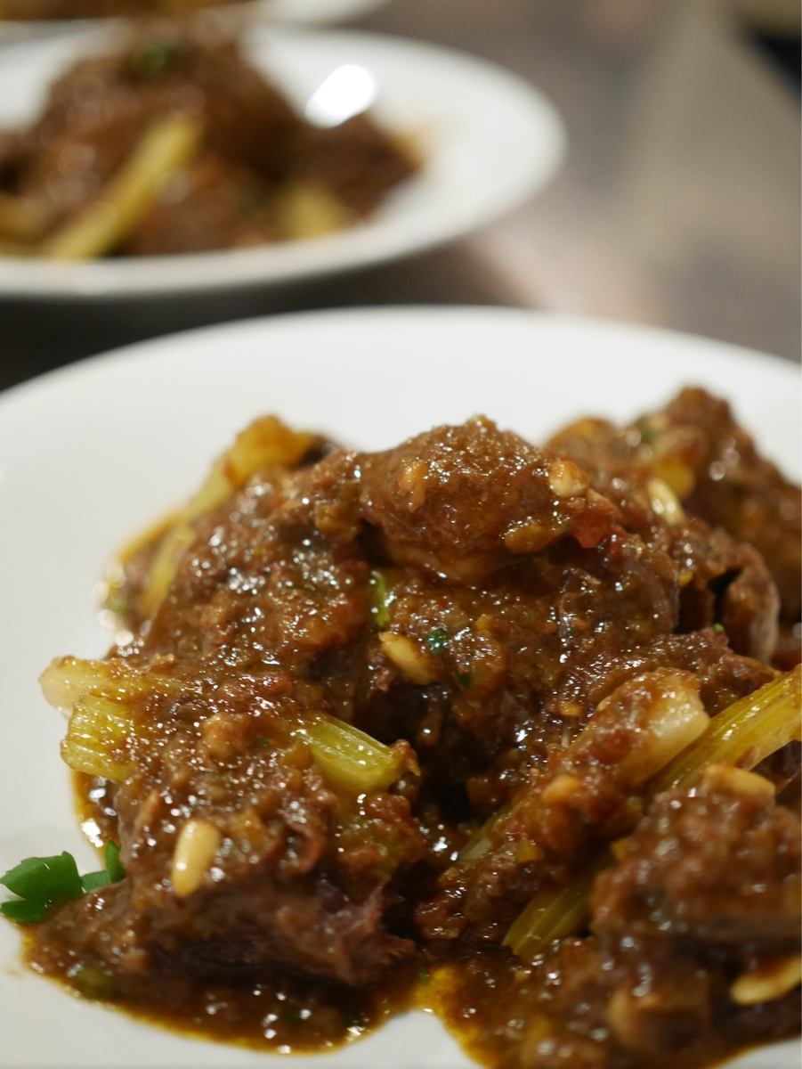 CODA DI BUE ALLA BACINARA Meat dish with beef tail and meat meat Roman cooking