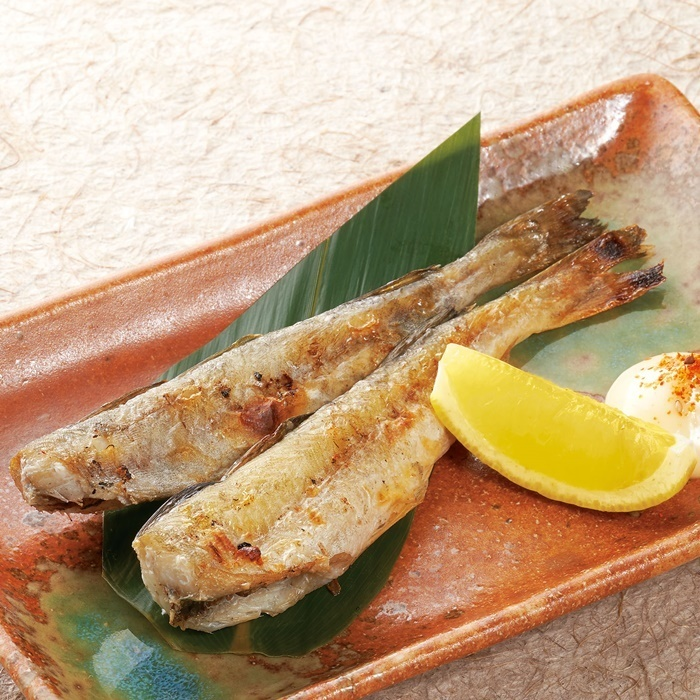 Grilled fish under a ice cube
