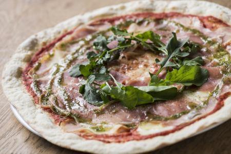 Parma ham and sliced potatoes pizza