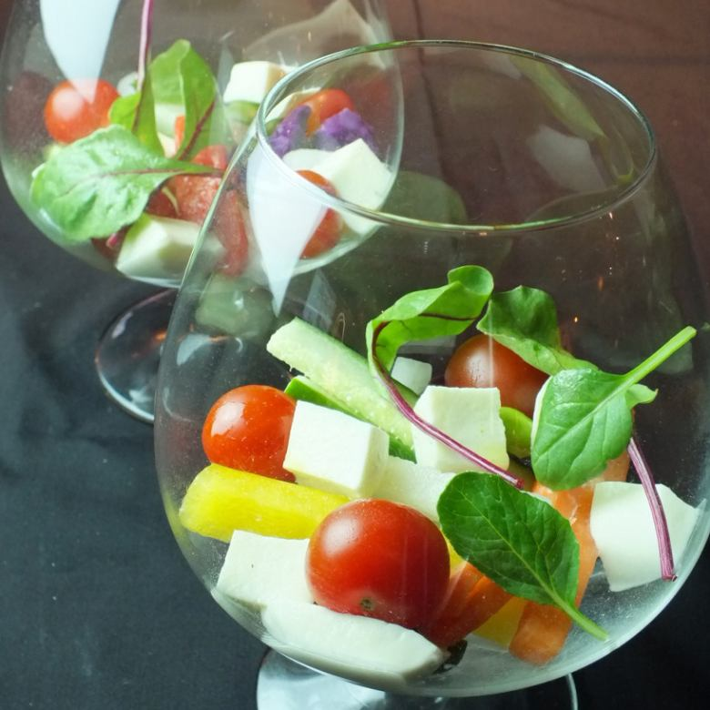 Caprese style of colorful vegetables and cheese