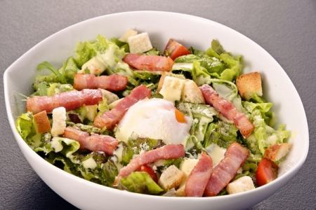 Caixar salad with hot spring egg, bacon, homemade croutons
