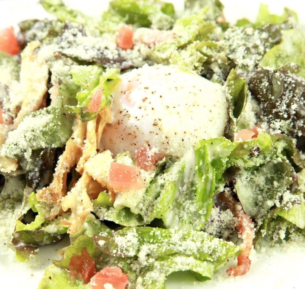 Caesar salad with warm bean egg