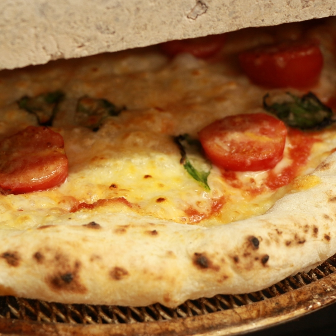 Handmade handmade pizza using stone kiln boasted by the manager