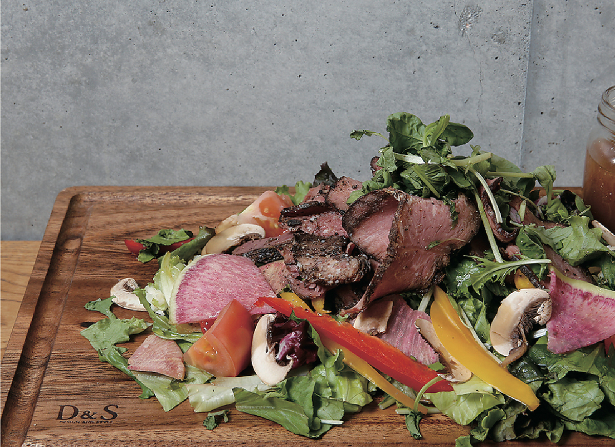 Luxurious salad plate with roast beef and raw ham
