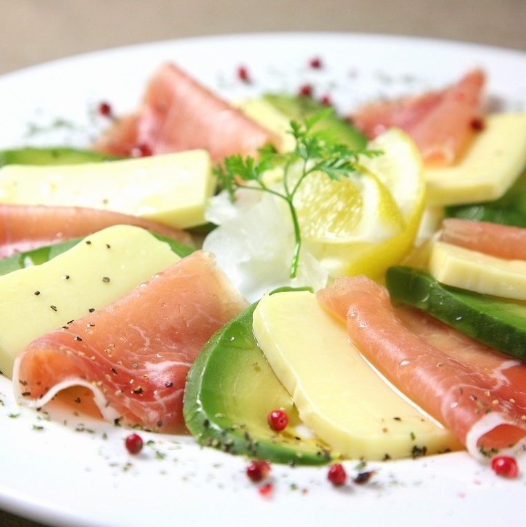 Pick cheese with raw ham and avocado