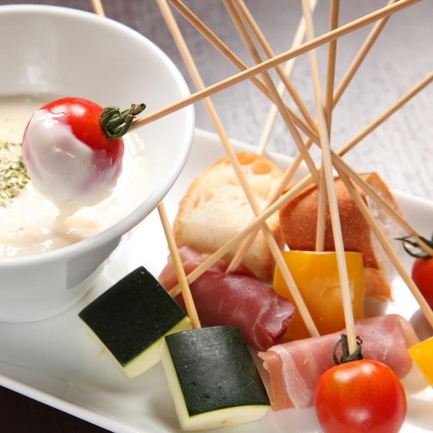 Seasonal vegetable creamy cheese fondue
