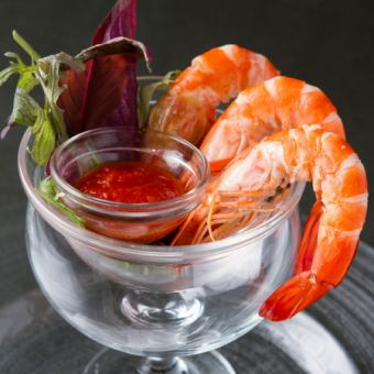 New Caledonian angel shrimp with a spicy cocktail sauce with a poche halapeno