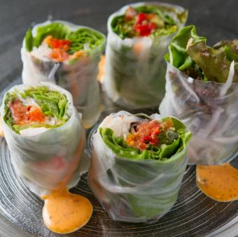 Salmon and avocado, raw green spring vegetable spring roll sweet chili sauce