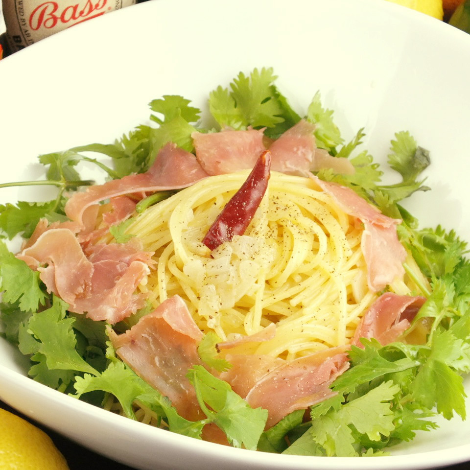 Paper tea covered with peperoncino raw ham