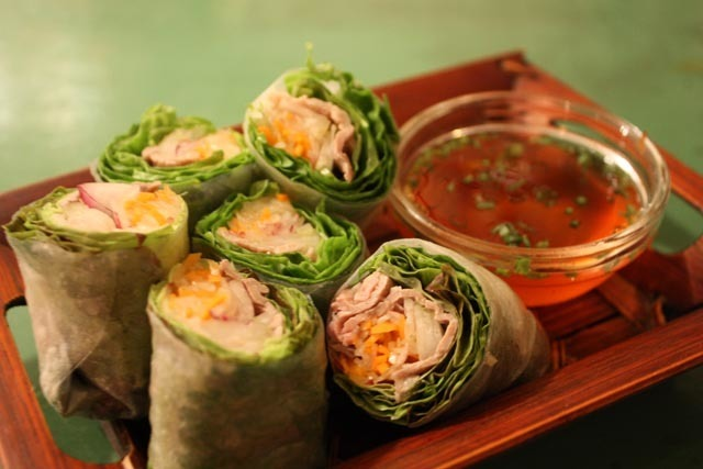 Raw spring roll of beef and celery