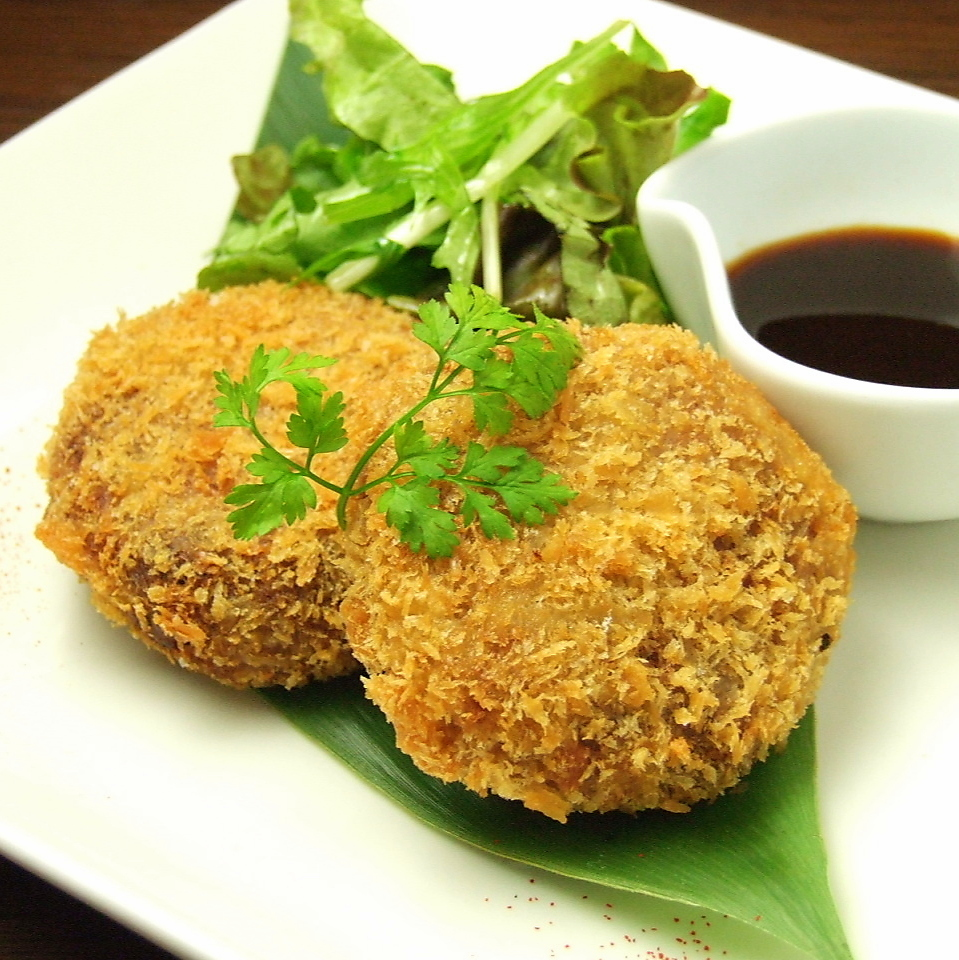 Handmade red pot and croquette
