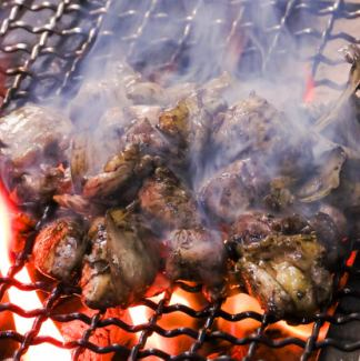 Charcoal grilling of local chicken