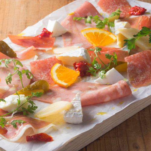Assorted plates of prosciutto and cheese