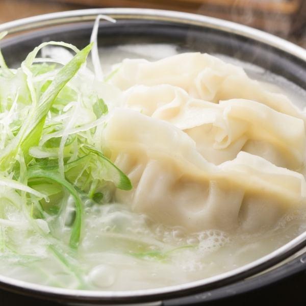Dense chicken soup stock cooked dumplings