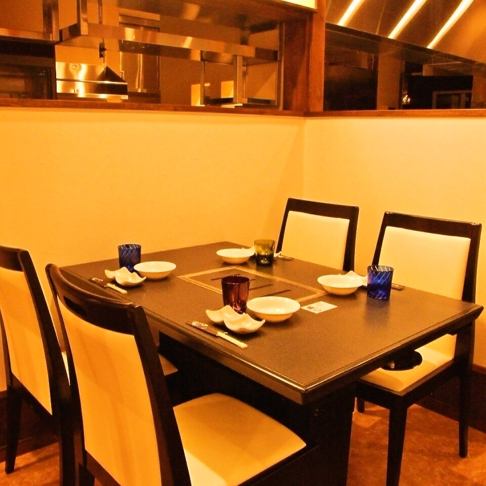 Semi-private room style table seats for 4 people