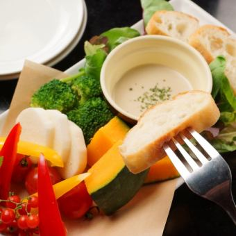 Bagna cauda over of colorful vegetables