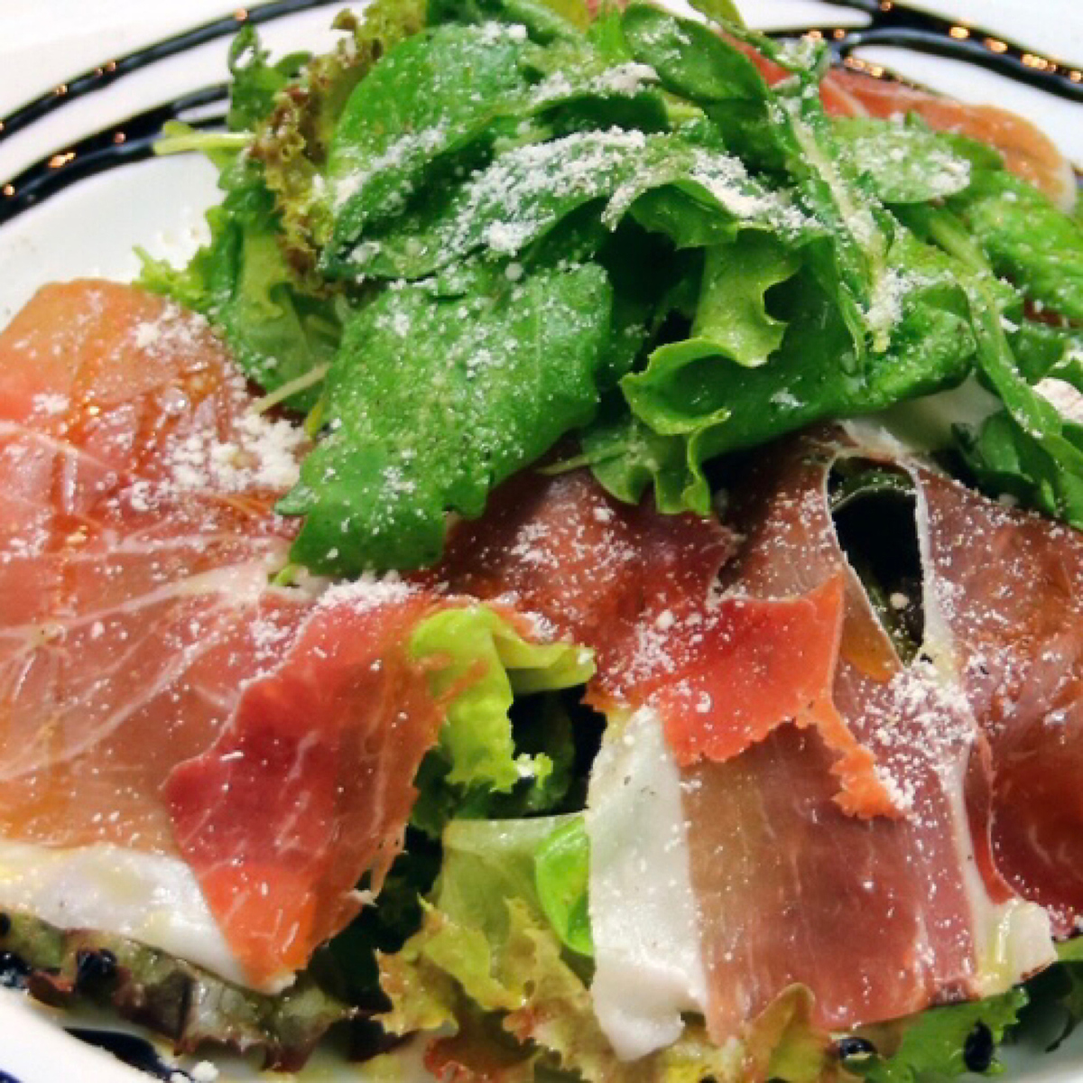 Italian salad with raw ham and mizuna