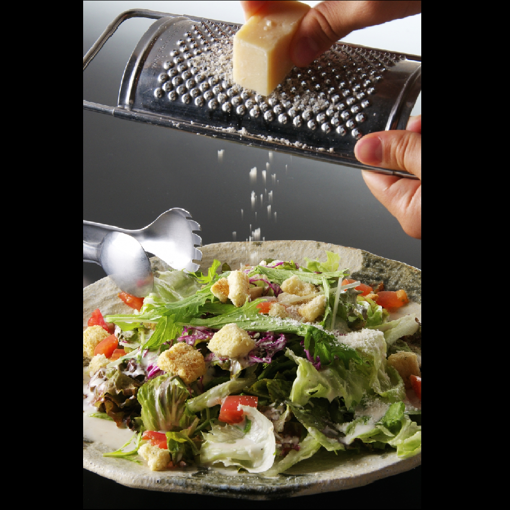 Caesar salad with grated cheese