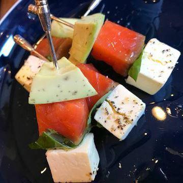 Pinchoss of seasonal fruit and raw ham nut