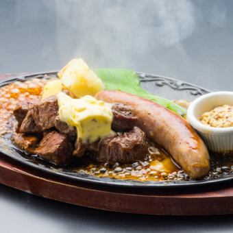 Domestic cattle steak and raw sausage