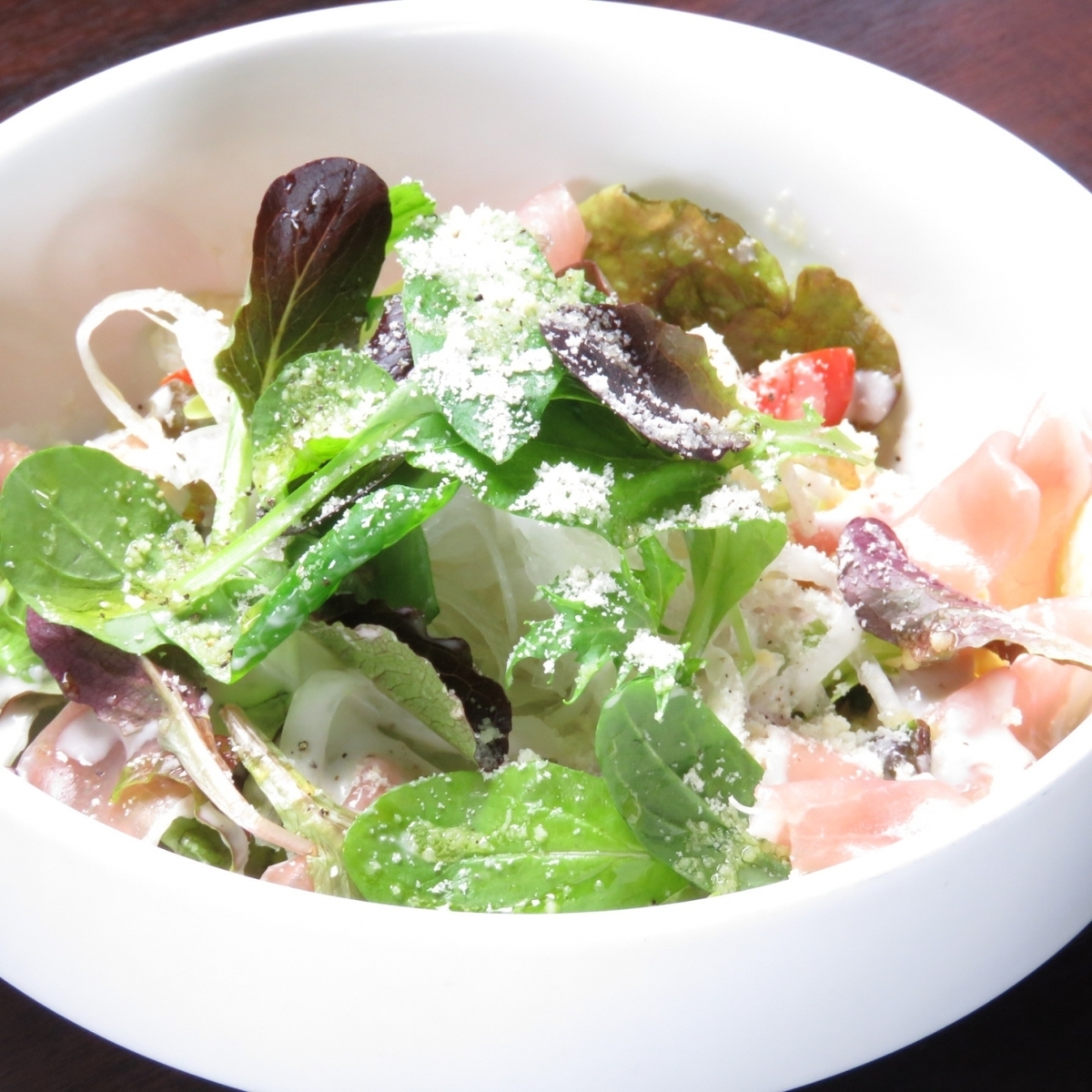 Caesar salad with raw ham and Rucola
