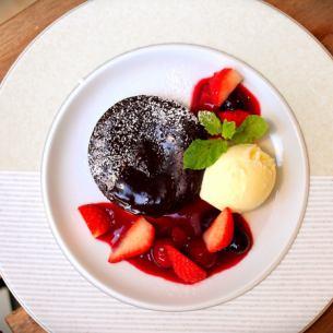 Fondant chocolate with vanilla ice Berry strawberry sauce