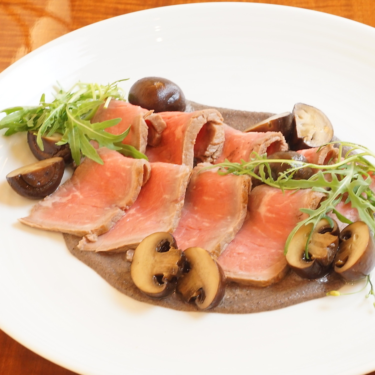 Roast beef with black truffle sauce and brown mushroom confit