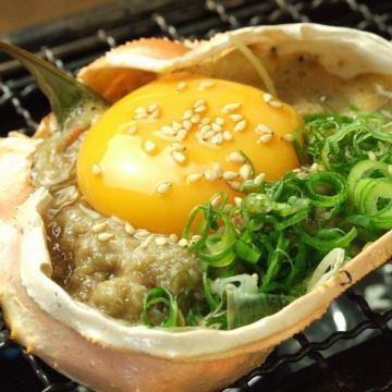 カニ味噌グリル(カニ味噌・玉子・特製ダレ)