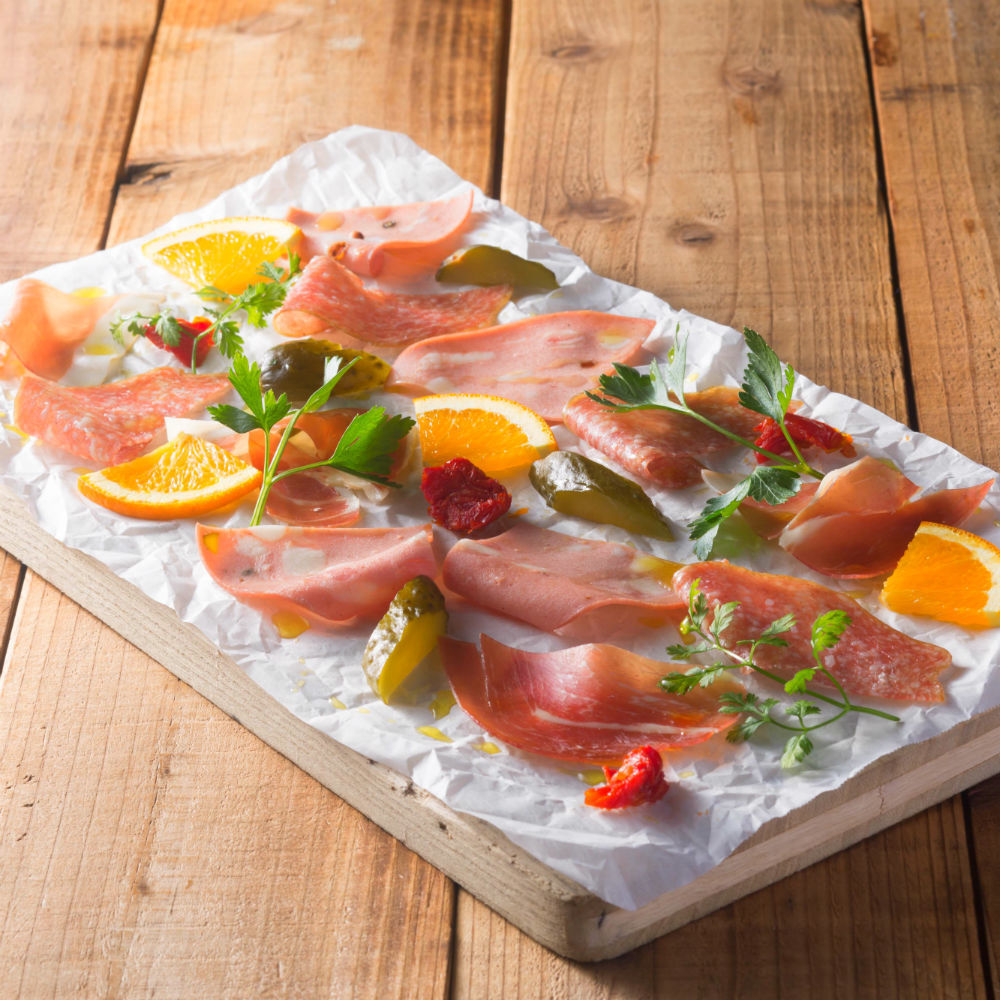 Plates of raw ham and salami