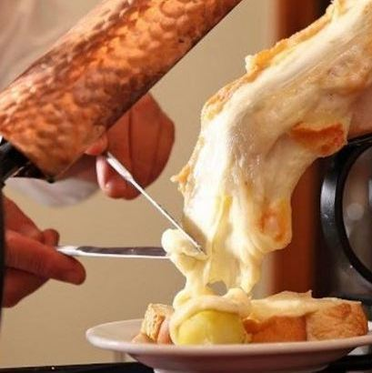 Assorted raclette cheese hot vegetables