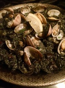 Squidka and clam squid ink black Paella