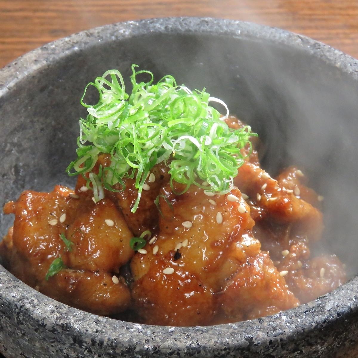 Stone-cooked jujuu chicken