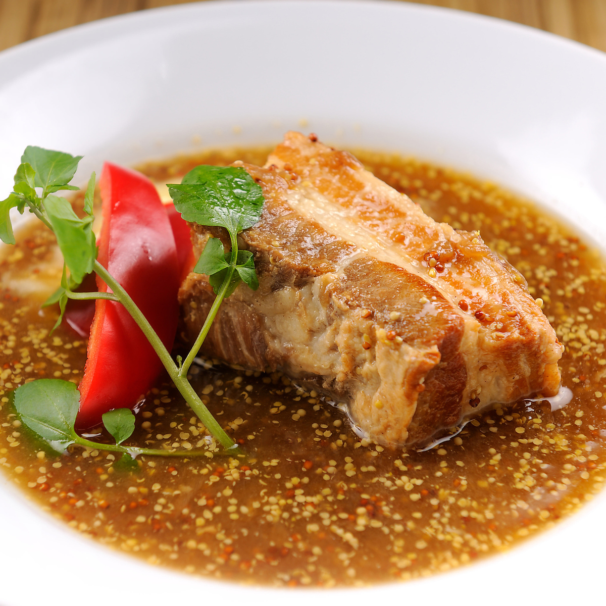 Pork belly, served with white wine stew