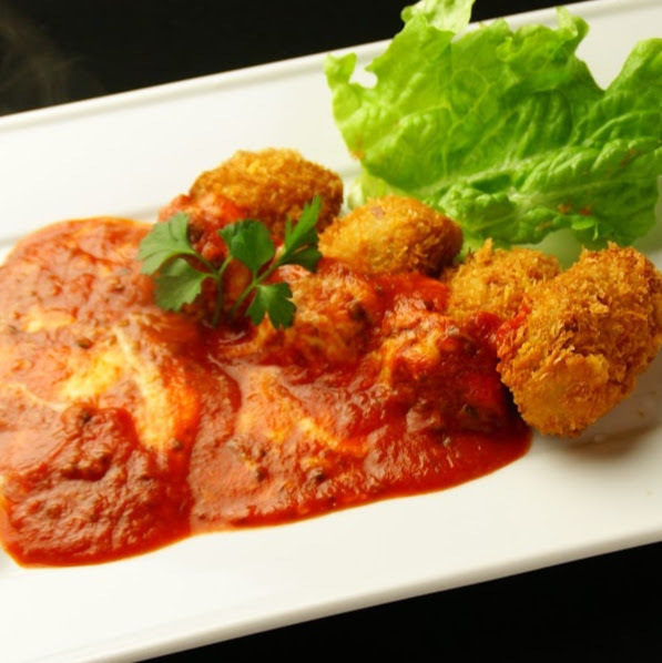 Oyster fried tomato cheese sauce