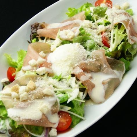 Caesar salad of raw ham and soft-boiled egg