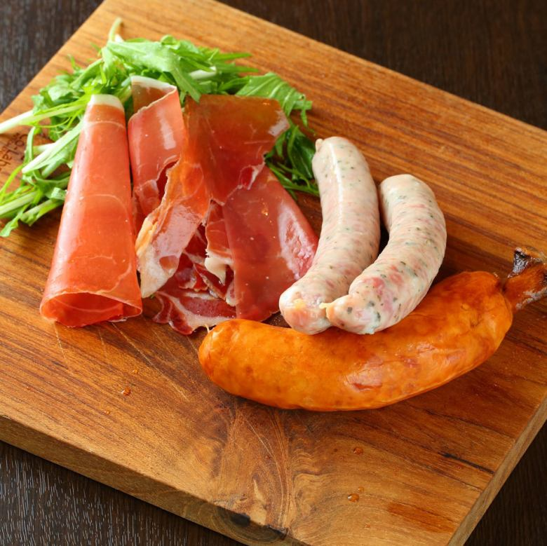 Assortment of raw ham and sausage