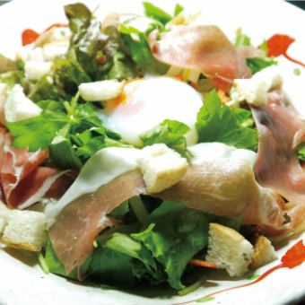 Caesar salad with raw ham and hot spring egg