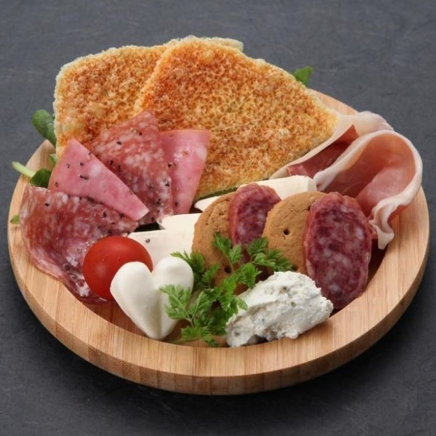 Assortment of cheese and raw ham