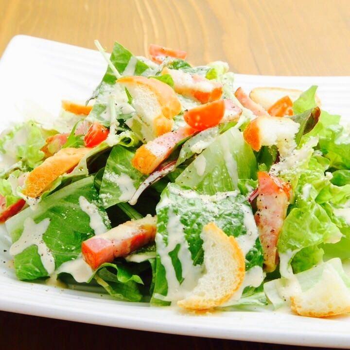 Raw ham of Caesar salad