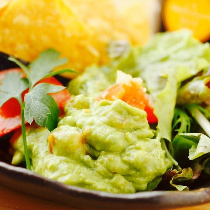 Avocado dipped with corn chips